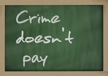 Crime doesn't pay written on a blackboard