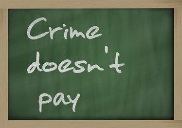 Crime doesn't pay written on a blackboard